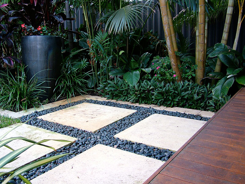 Pavers and pebbles in tropical garden nedlands