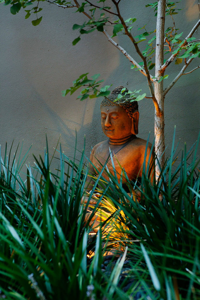 Garden Buddha statue in a beautiful garden
