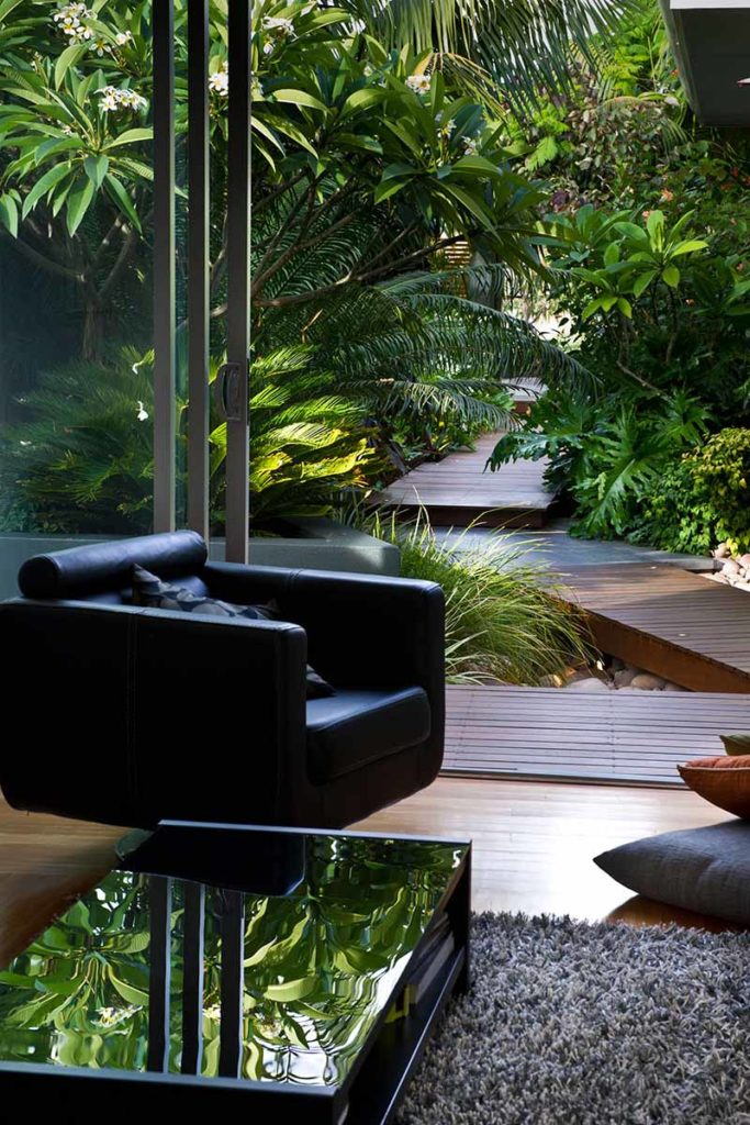 black chair overlooking tropical garden