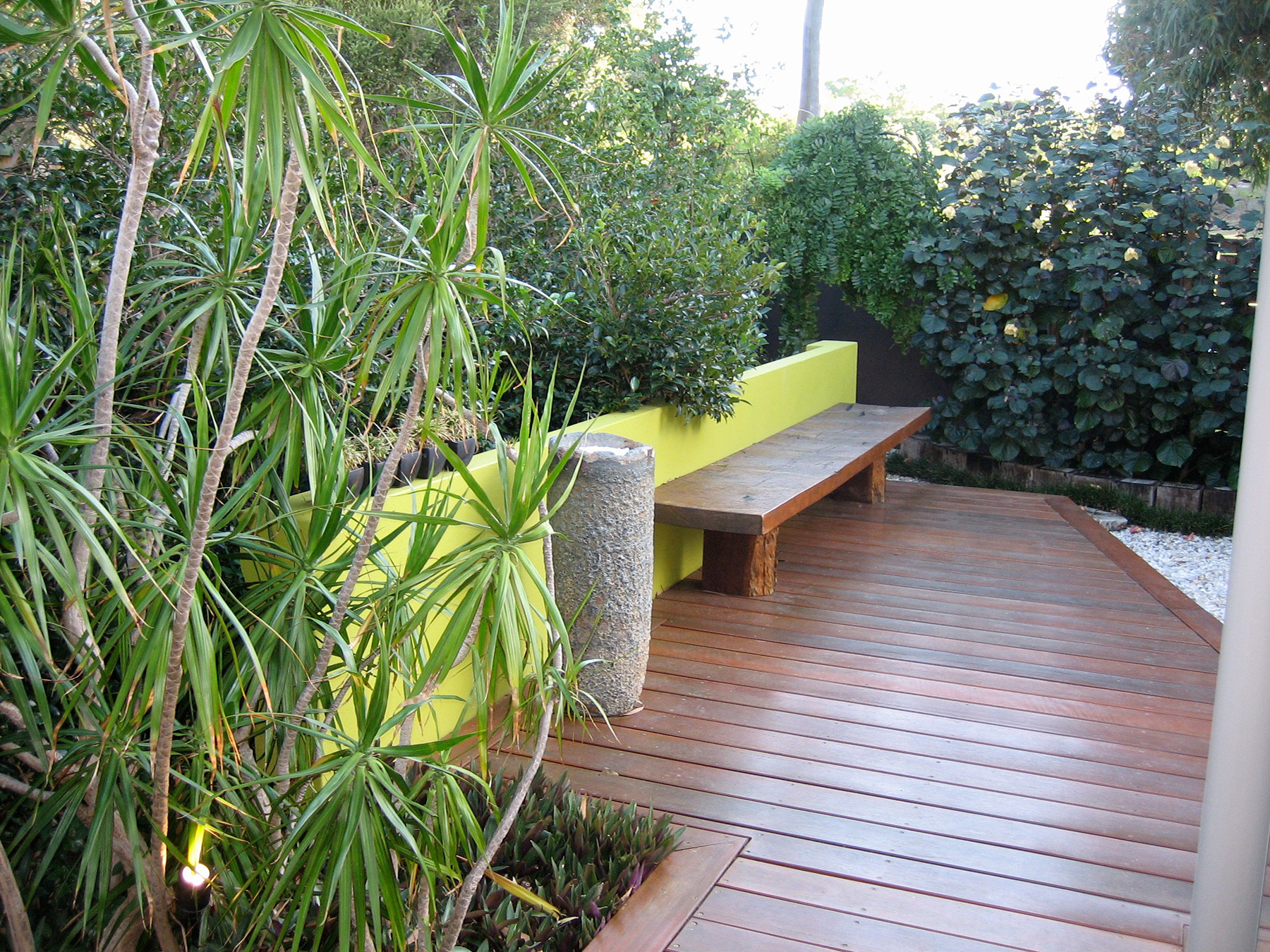 contemporary jarrah bench and crucible in courtyard garden