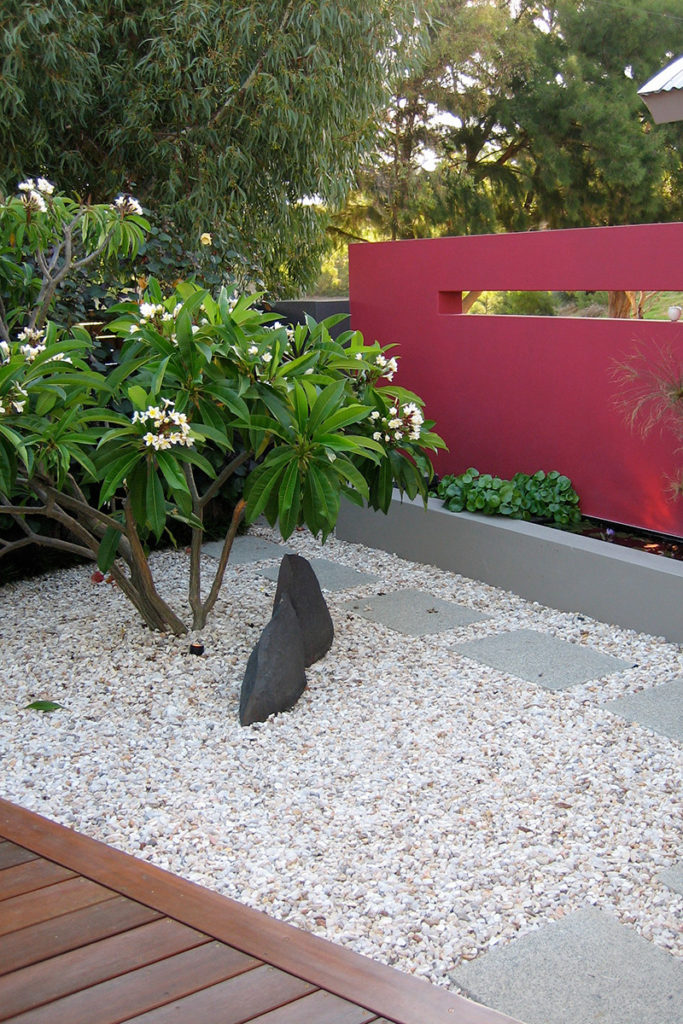 rock sculpture in gravel garden