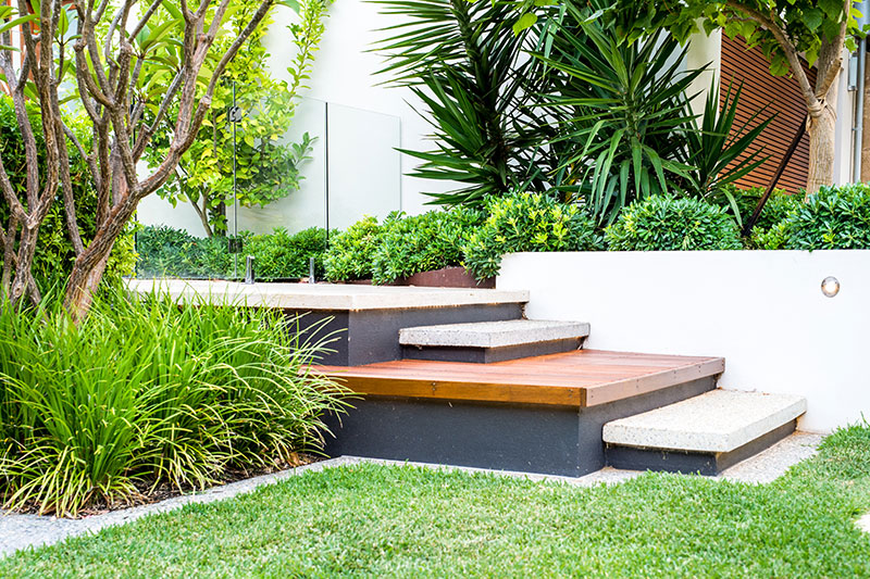 platform steps in garden to swimming pool