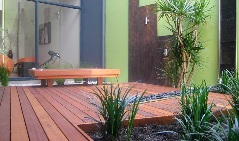 contemporary courtyard in subiaco with corten steel wall panels and timber decking