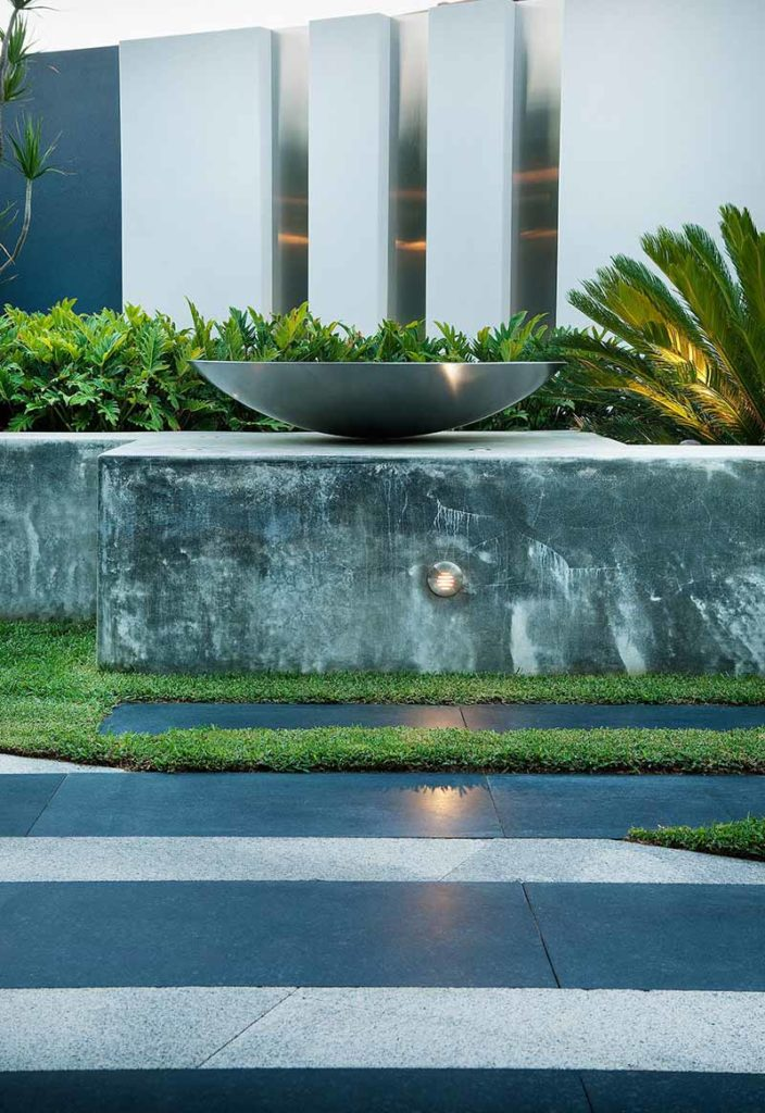 contemporary landscape design by Cultivart with concrete walls and stainless steel features