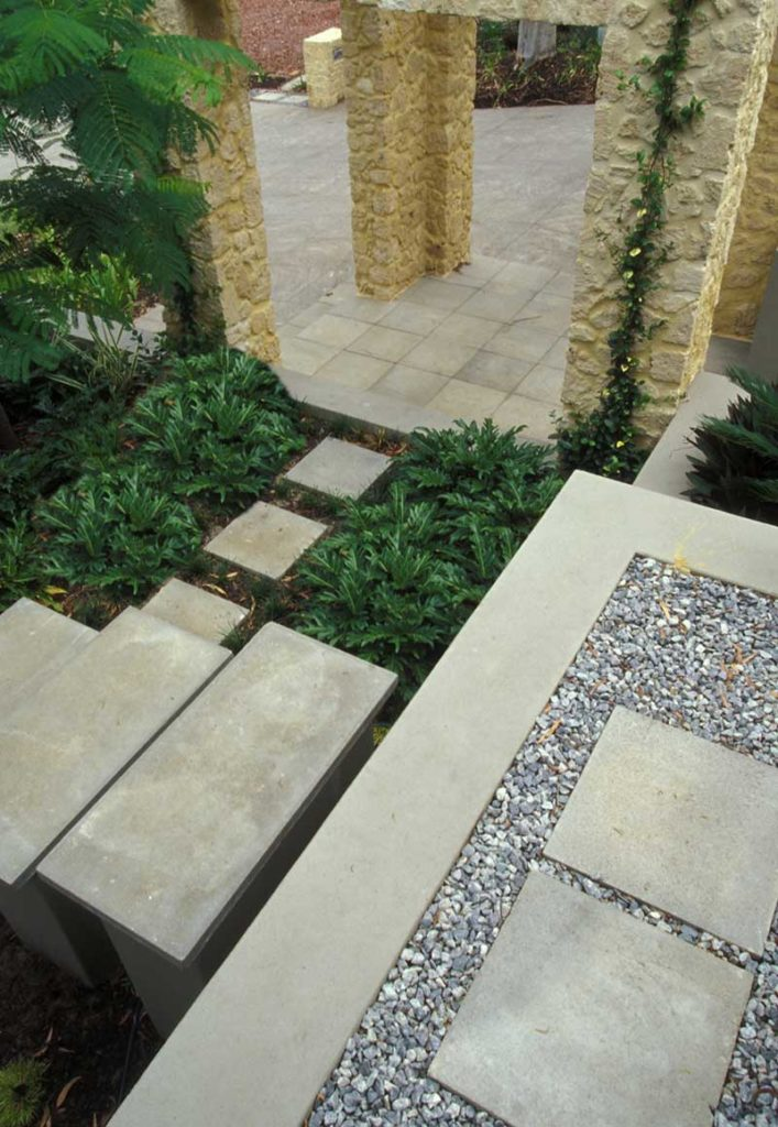 entry courtyard design in Swanbourne with limestone rubble gatehouse and freestanding steppers