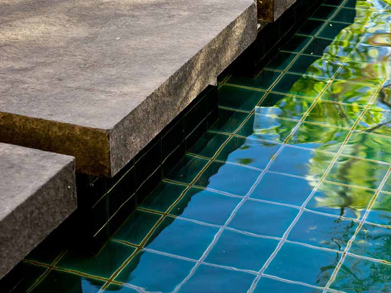 pond detail with granite steppers and tiles