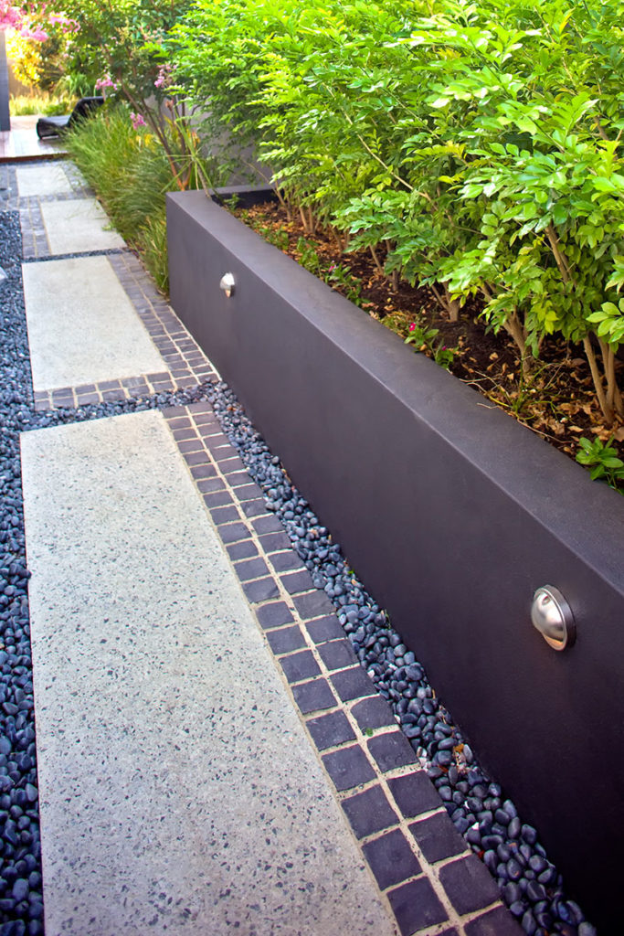 walkway with exposed aggregate and granite cobbles