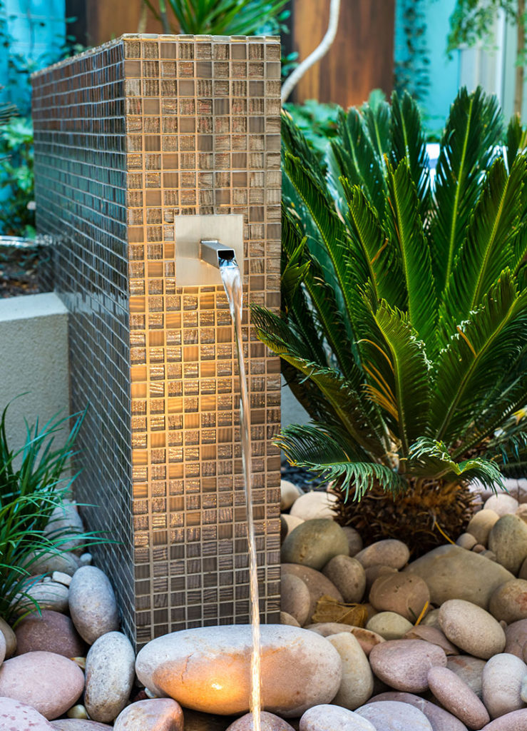 Modern water feature in beautiful garden